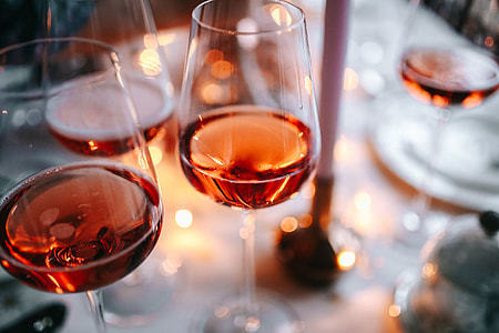 two glasses of rose wine on a dinner table at home