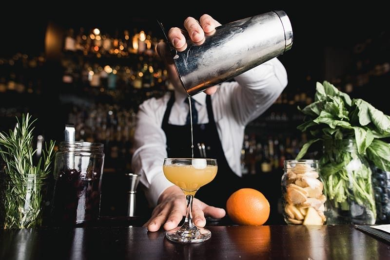 Bartender pouring craft cocktail