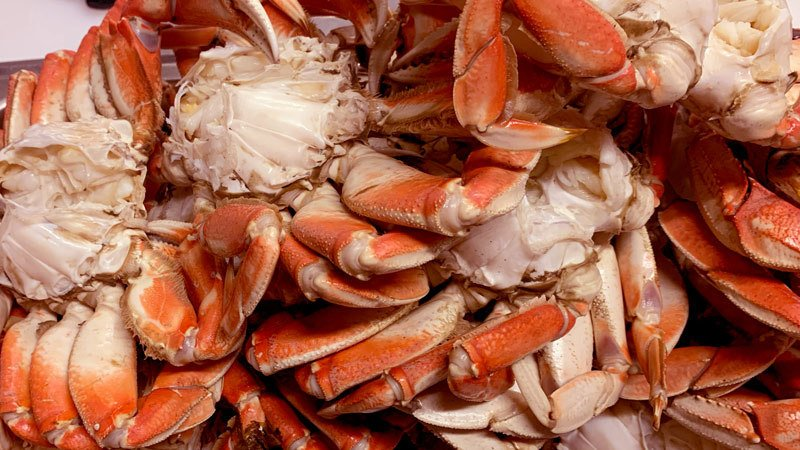 a pile of cleaned and cracked dungeness crab ready to eat