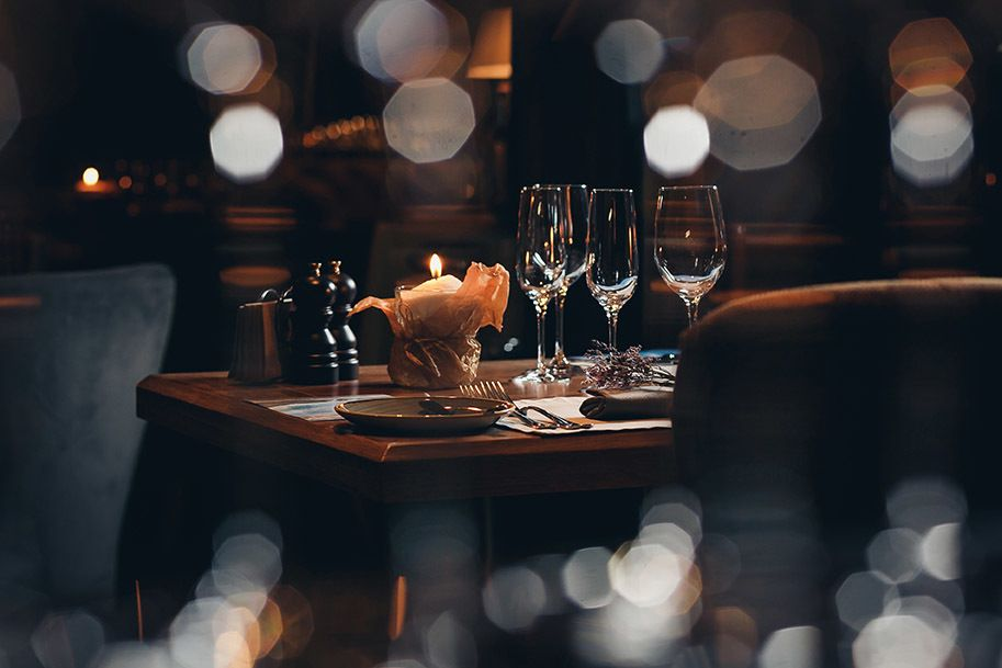 a restaurant table with a handsome setting for father's day